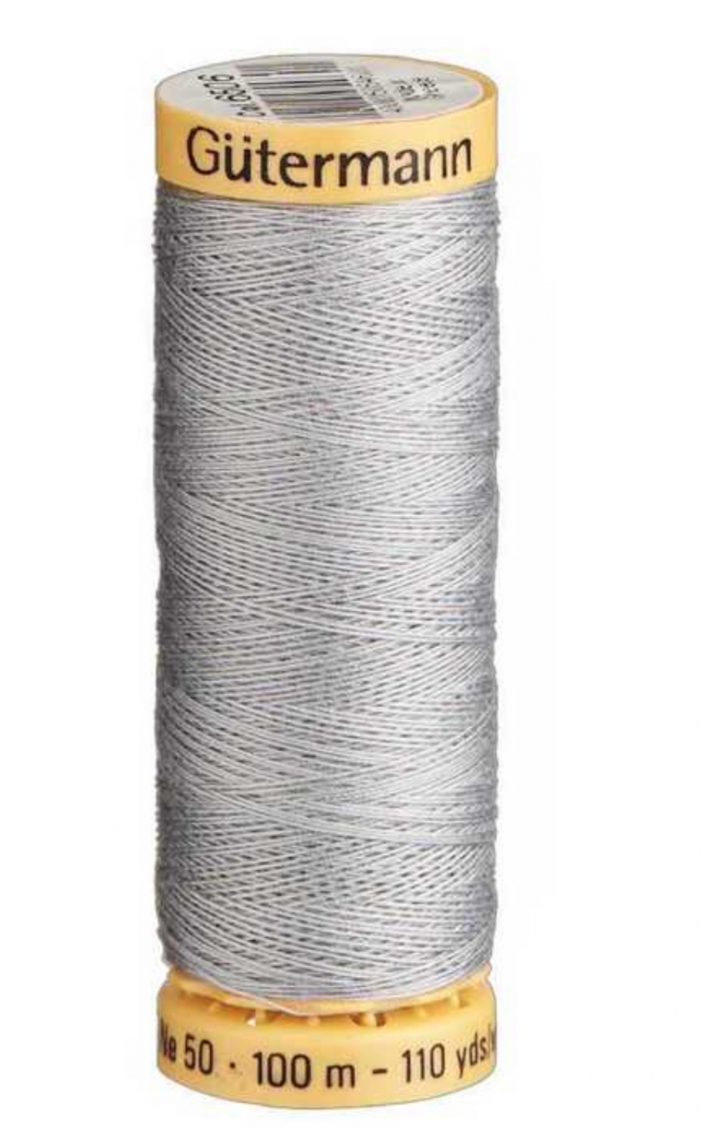 Silver grey spool of cotton thread