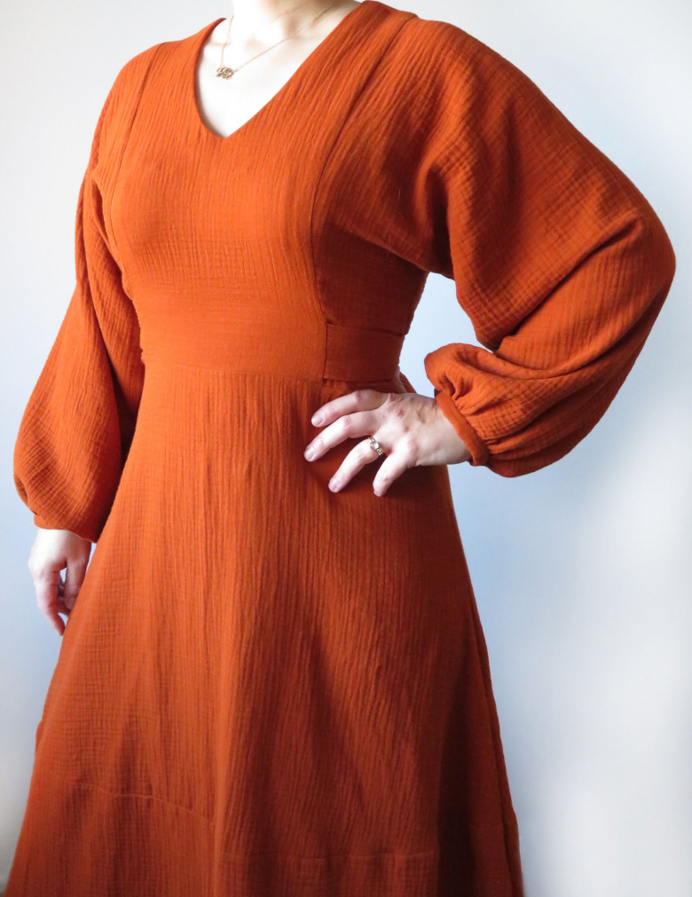 Belemnite dress - view A, front closeup, on model in rusty red-orange