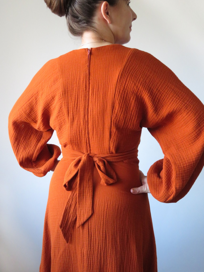 Belemnite dress - view A, back closeup, on model in rusty red-orange
