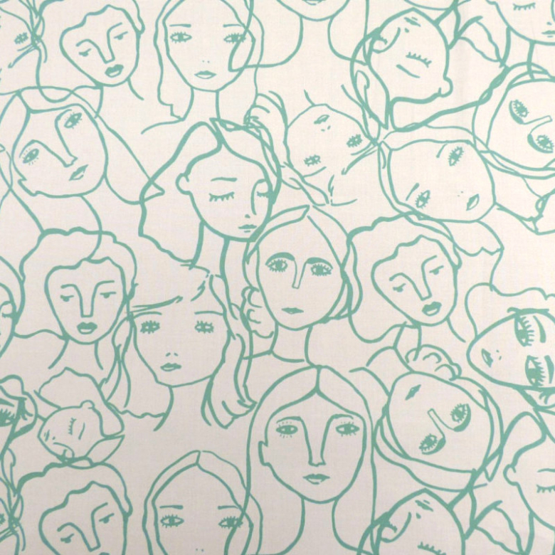 white fabric with faces outlined in light green