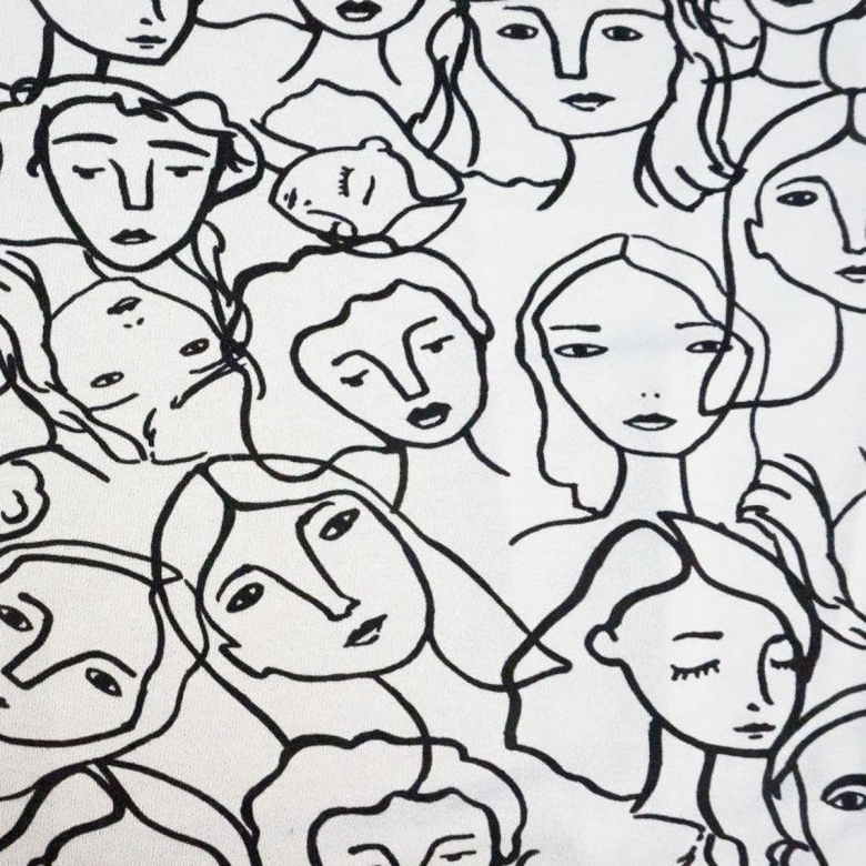 white fabric with faces outlined in black