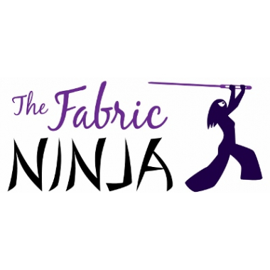 Black ninja figure with long hair wielding a sewing needle next to name The Fabric Ninja